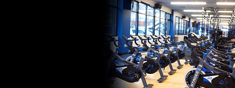 Image of a school athletic training room with 10 Stages Indoor Cycling SC3 bikes facing out a window