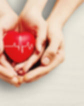 Man and woman holding red heart in.jpg