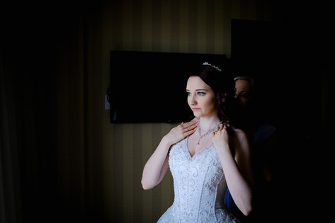 A beautiful bride getting ready at the Radisson Hotel Vancouver Airport in Richmond, British Columbia.