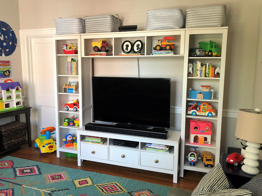 Ikea shelves as toy storage in playroom