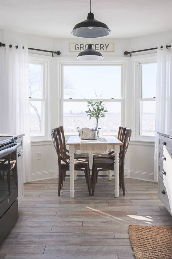 idea for covering bay window using two small rods for curtains