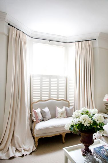 ideas for covering a bay window with draperies