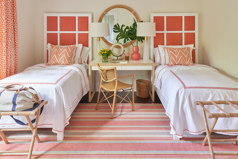 Coral and white sophisticated twin bedroom by Meg Braff