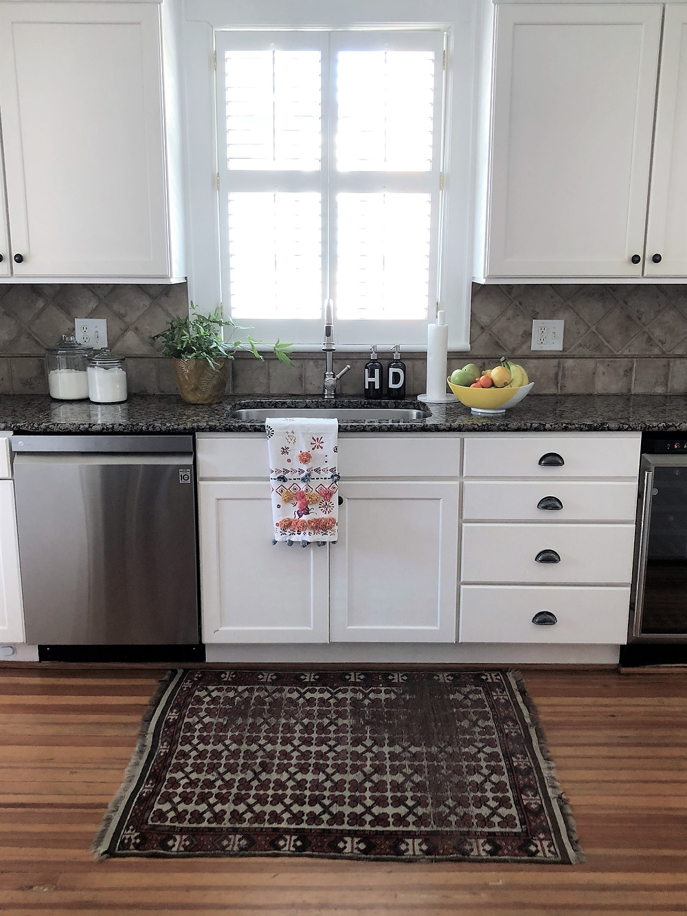 clean kitchen with vintage rug