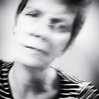 Portrait of Michela Griffith. Slow shutter and subject movement create intentional blur