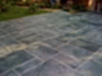 Ashlar slate scored, stained concrete ov