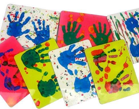 Children's handprints on personalised placemats.