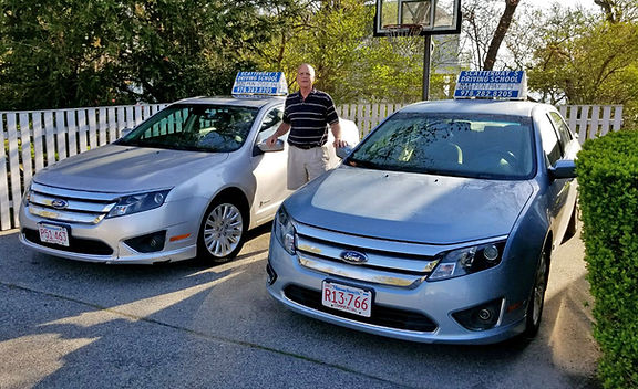 Dave Scatterday with Ford Fusion Hybrid Cars