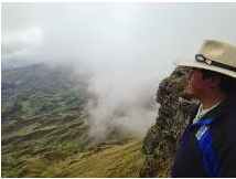 My friend, David Quispe, Mayor of Ccorca standing at 4300 meters, on Mama Simona - visable from Cusco!