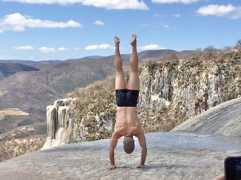 Patrick doing a handstand in Hierve el Agua