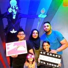 family has fun at breakout escape games playing puzzle room