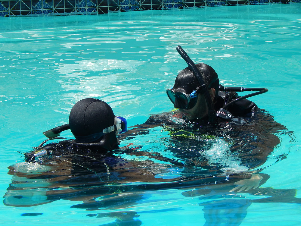 A student prepares to descend to the first time in the pool.