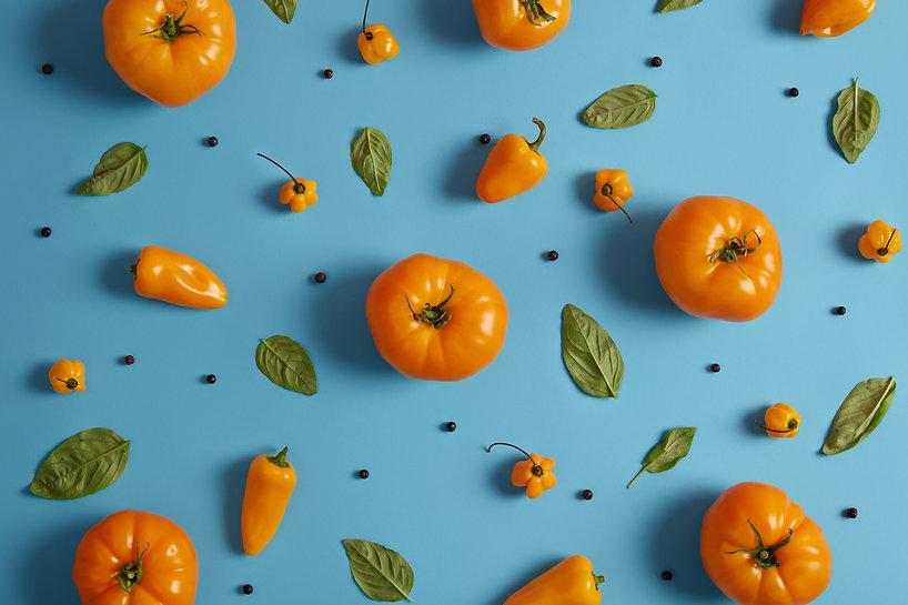 shot-of-ripe-yellow-tomatoes-paprika-pep