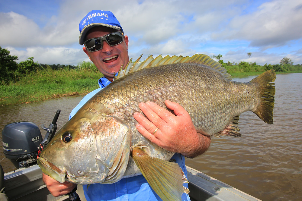 Al Mcglashan with a hefty PNG Black Bass!