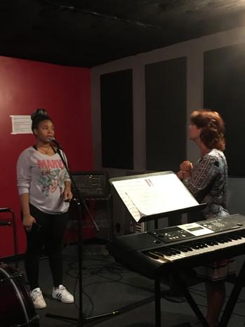 Rita Marie DiNico working one-on-one with Zaryah