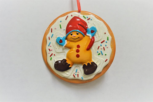 gingerbread boy on a cookie with a red hat
