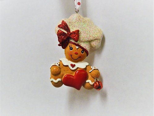 gingerbread chef with hairbow and heart
