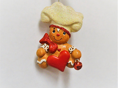 gingerbread chef with bow-tie and heart