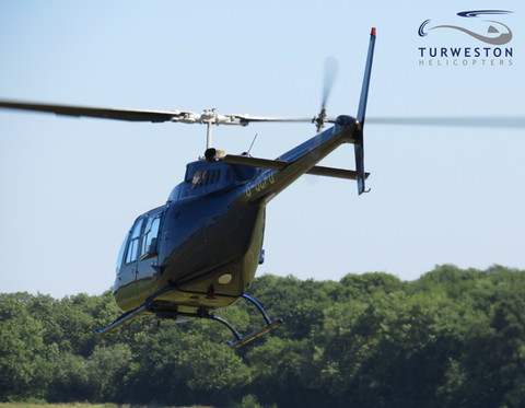 Turweston Helicopters departing in G-OCF