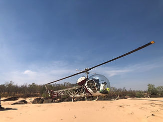 Bell 47 Helicopter Parked On Sand