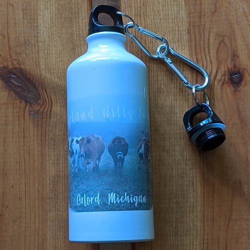Water bottle with cow logo