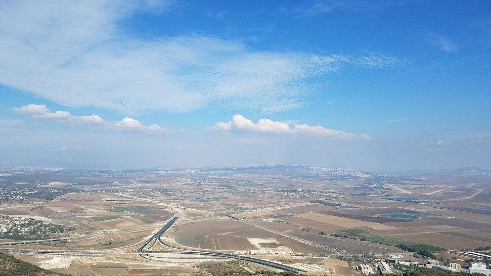 meggido valley overlook blue sky clouds.
