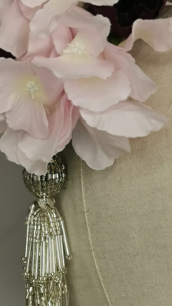 Pink hydrangea, purple anemone with silver beaded tassle