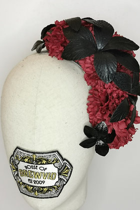 Burgundy carnations and black faux leather effect orchids
