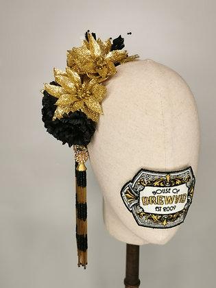Gold glitter ponsietta with black carnations