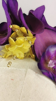 Purple orchid with metallic gold millinery