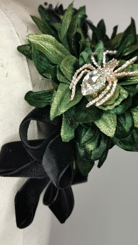 Metallic green dahlias, black carnations