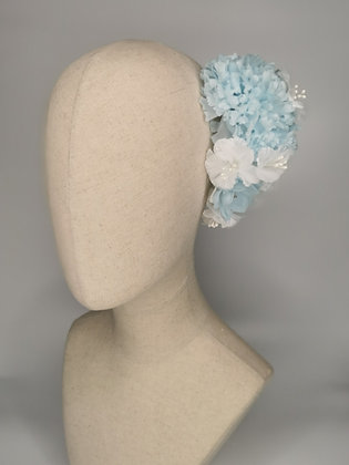 Blue Carnations with white mini hibiscus millinery and a sky blue acrylic flower