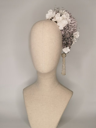 Lilac grey chrysanthemums frosted white blossom with silver millinery