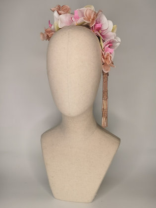 White and pink orchids with rose hydrangea and a pair of rose beaded tassels