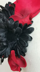 Bold red orchid, black gerberas and pear