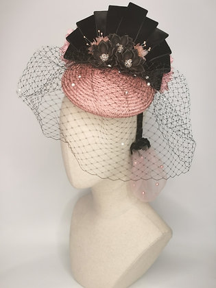 Pink straw tilt hat with black acrylic flowers and velvet detail, pink millinery