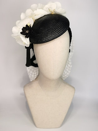 Black straw tilt hat with white orchid, black acrylic flower with crystal effect