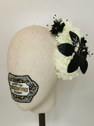 White carnations with black faux leather orchid