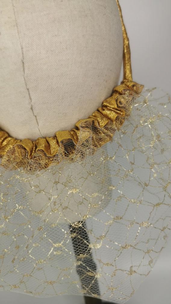 Gold detail mesh with metallic gold trim