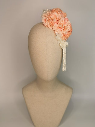 Blush pink zinnias with white millinery flowers and a white beaded tassel