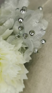 White Carnations and silver millinery