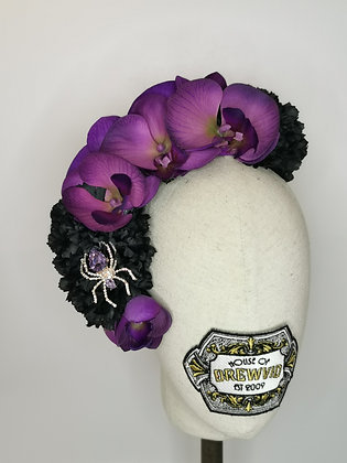Purple orchids and black carnations