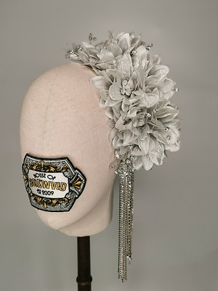 Silver metallic dhalias with matching millinery baby's breath