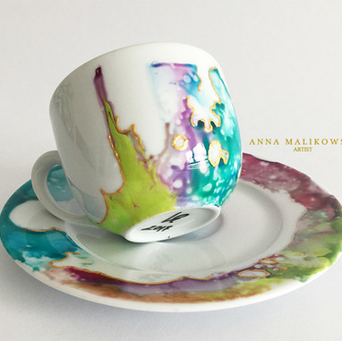 Porcelain cup Hand painted, decorated with gold. Capacity 120ml