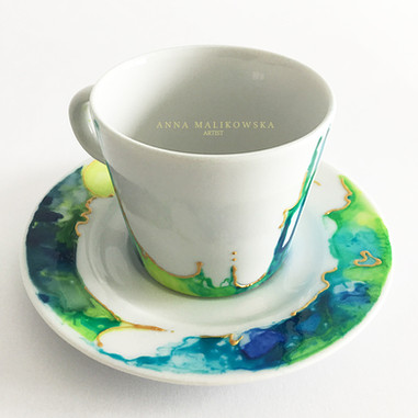 Porcelain cup. Hand painted, decorated with gold. Capacity 120ml