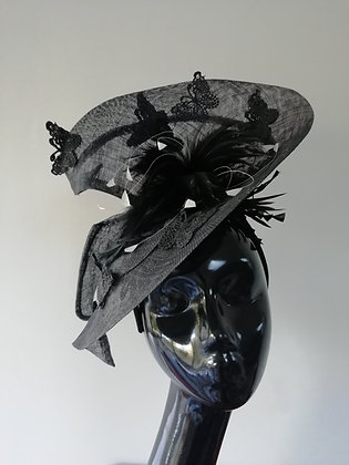 Black sinamay fascinator with black butterflies and black feather flower
