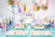 Little girl birthday party table with un