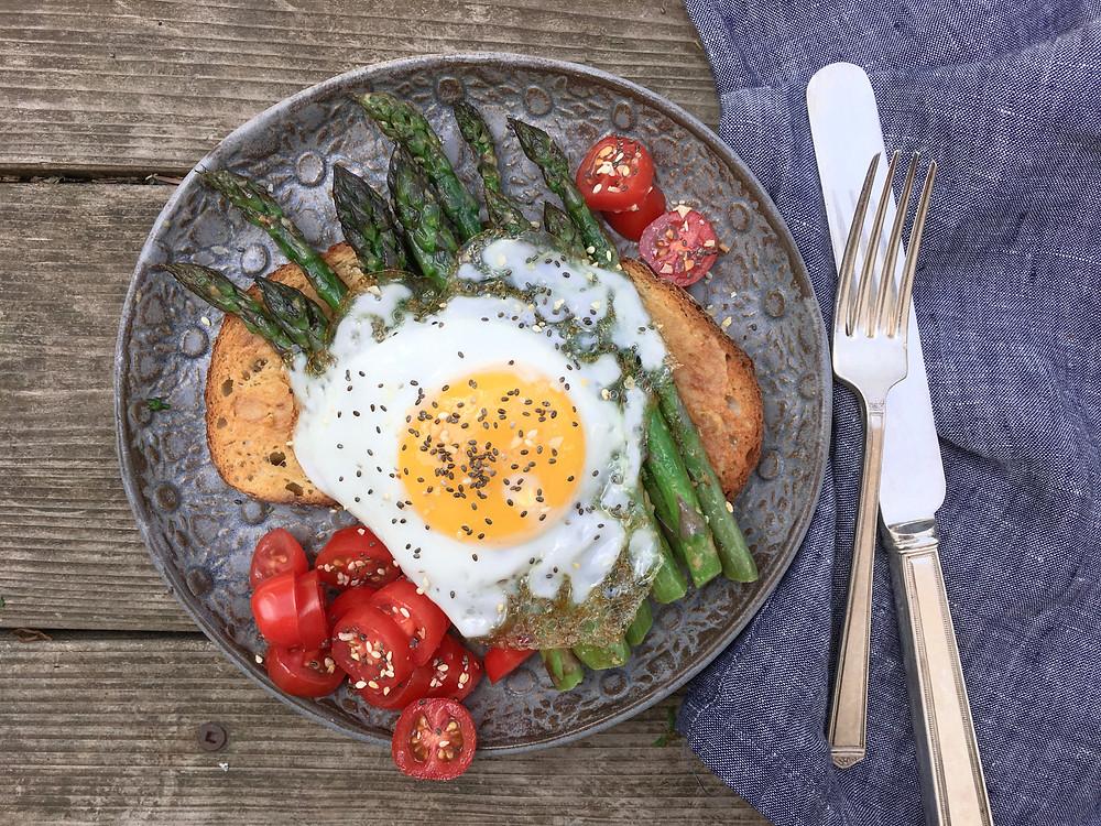 asparagus with an egg on it