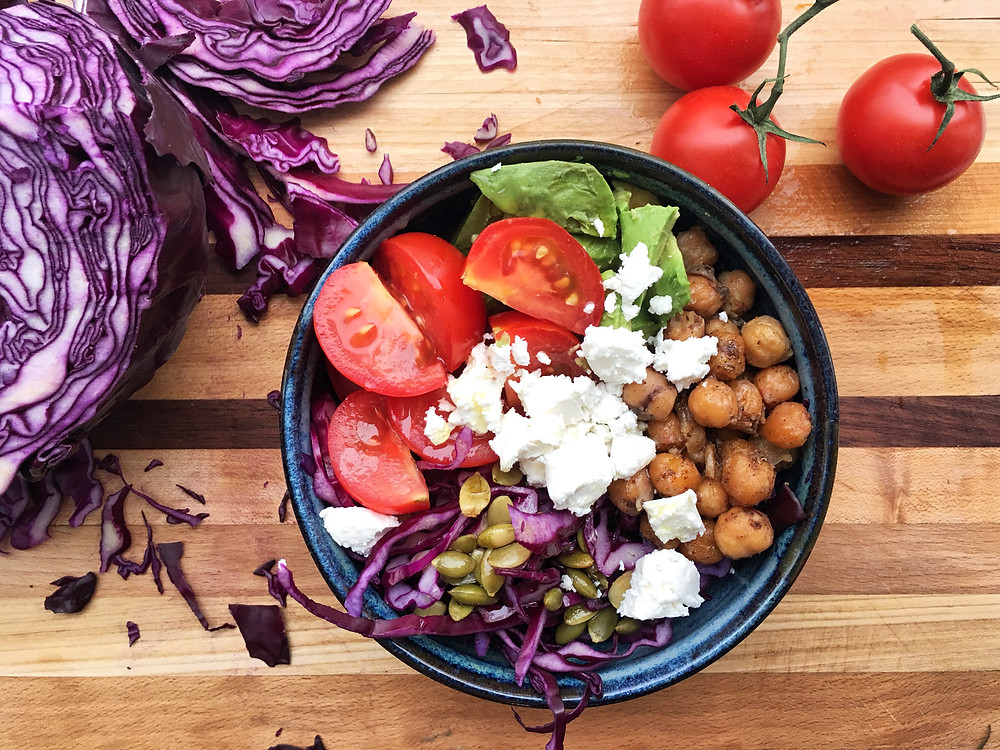 chickpea salad on wooden board