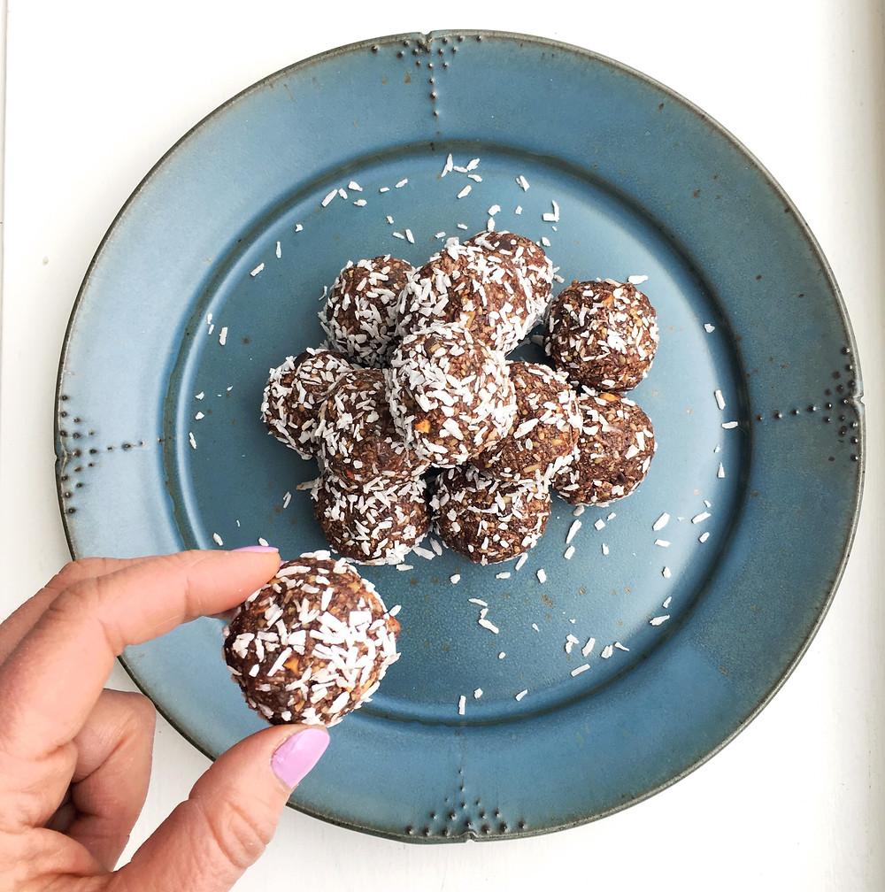 dark chocolate energy bites on a plate